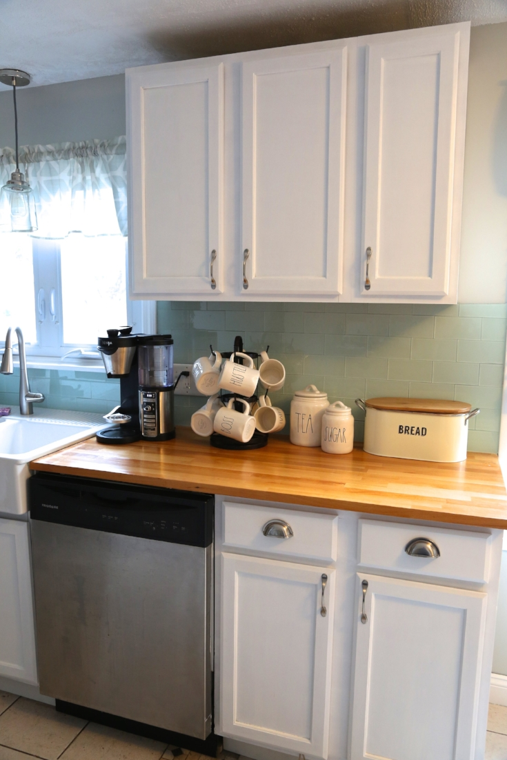 Adding crown molding to your kitchen cabinets. - Weekend Craft