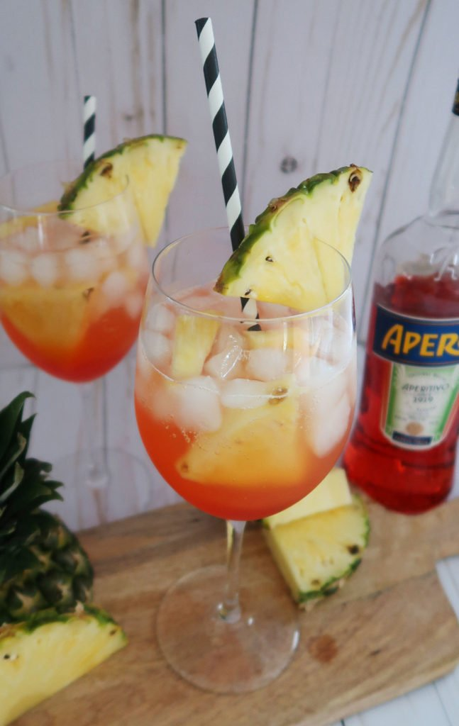pineapple aperol spritz with straws